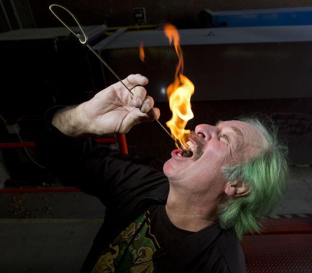 Johnny Green eats fire